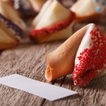 Fortune cookies decorated with red candy sprinkles close-up. horizontal