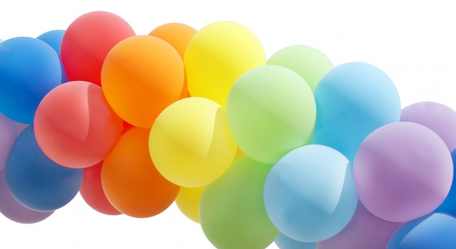 Colorful balloon forming a archway isolated on white